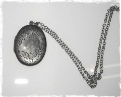...an antique silver locket, a keepsake of Natalie.